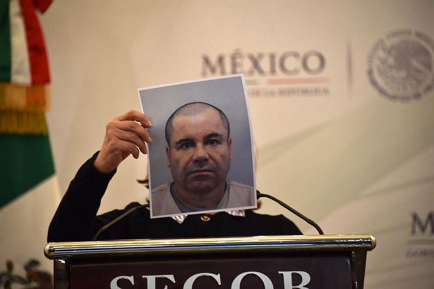 Mexico's Attorney General Arely Gomez shows a picture of Mexican drug kingpin Joaquin 'El Chapo' Guzman during a press conference held at the Secretaria de Gobernacion in Mexico City.