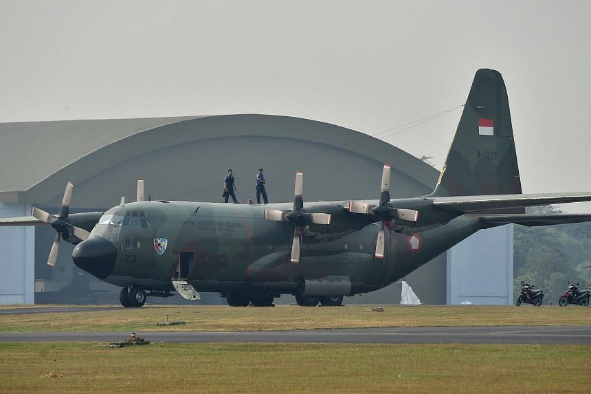 An Indonesian Air Force C-130 Hercules aircraft parked on the tarmac at Halim Air Base in Jakarta.
