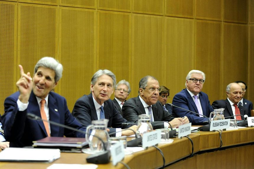 US Secretary of State John Kerry (left) British Foreign Secretary Philip Hammond, Russian Foreign Minister Sergei Lavrov, German Foreign Minister Frank-Walter Steinmeier and French Foreign Minister Laurent Fabius take part in a press conference in Au