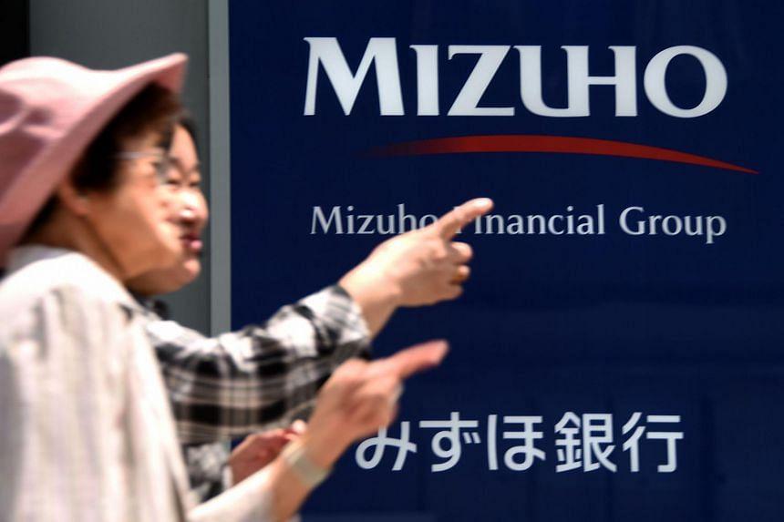 Bank giant Mizuho said Athens has transferred 20 billion yen (S$220 million) to cover its yen-denominated debt.