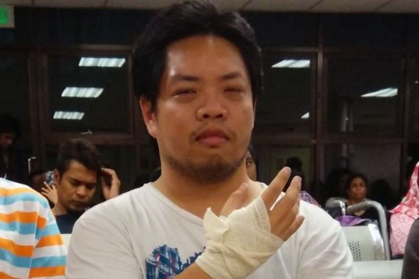 Sin Chew Daily crime reporter Chan Woei Loon, who was attacked while covering the brawl at Low Yat Plaza on Sunday, July 12, 2015, said that he was saved by several Malay men.
