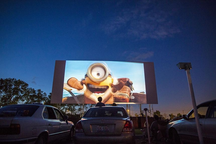 A boy watching the Minions movie at the Cascade Drive-In theatre in West Chicago, Illinois.