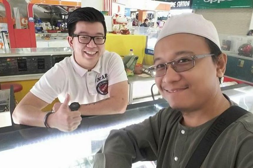 Mr Fais al-Hajari with mobile phone seller Desmond, in a picture that was posted on Facebook and shared on social media.