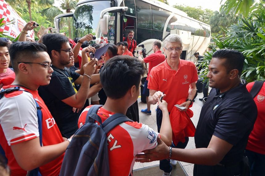 Arsenal players arrive at the Shangri La Hotel in Singapore on July 13, 2015.