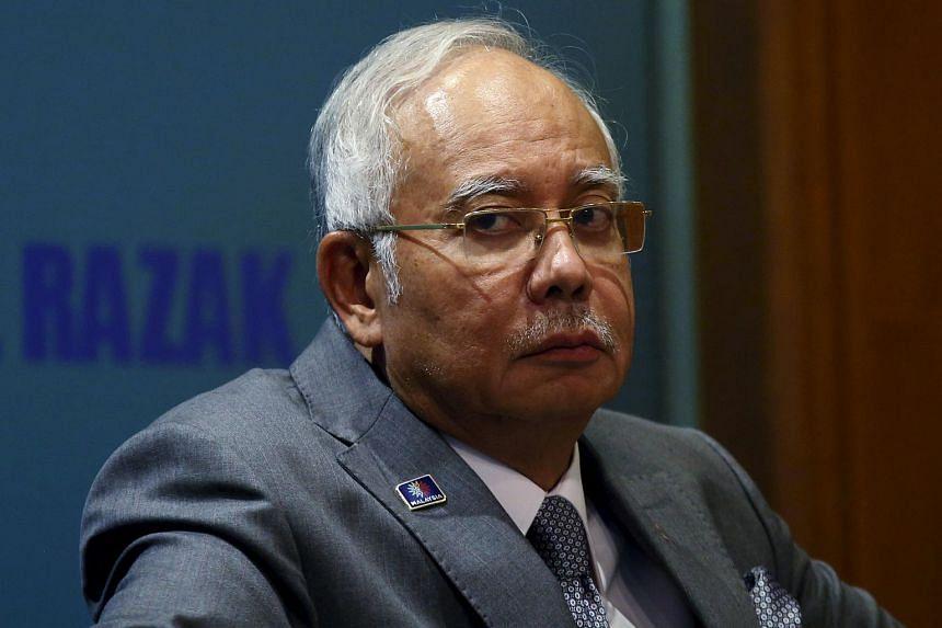 Malaysian PM Najib Razak attending a presentation in Putrajaya on July 8.