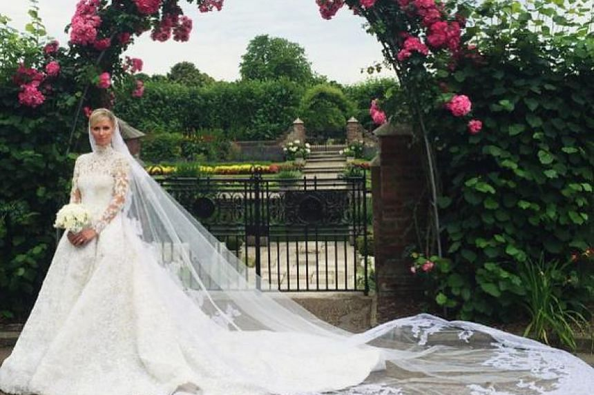 Nicky Hilton in her custom-made Valentino wedding gown at the Kensington Palace. She got married to James Rothschild on July 10.