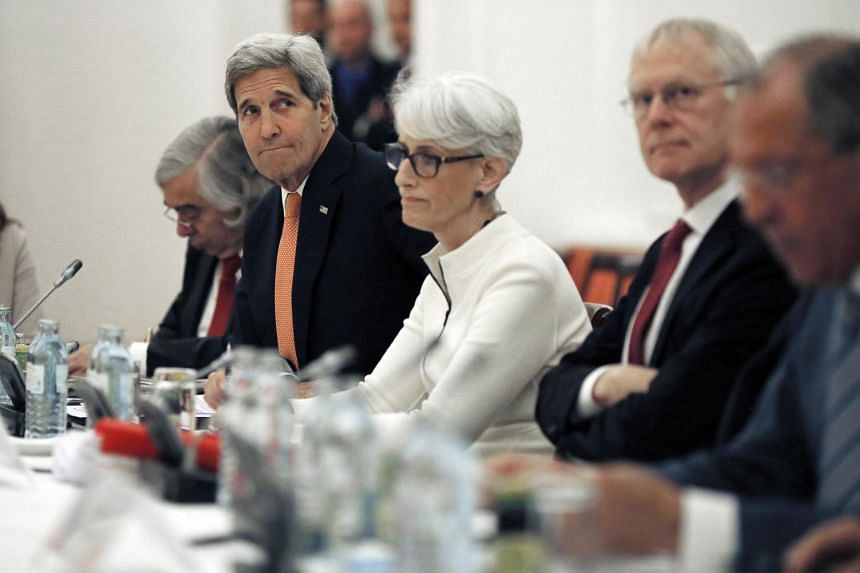 US Secretary of State John Kerry (second from left) with the other delegated at a hotel in Vienna during the Iran nuclear talks.