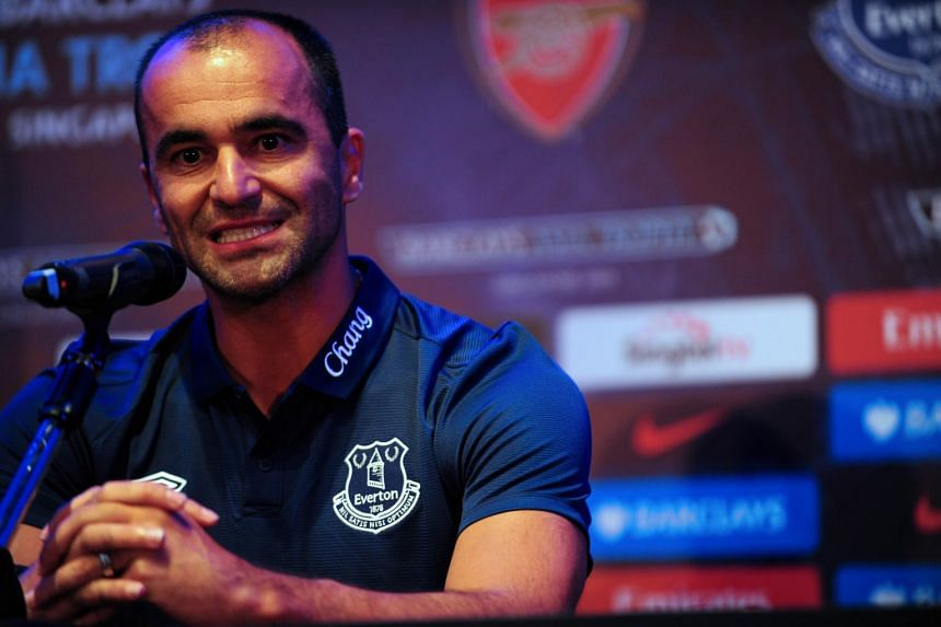 British Premier League football club Everton's Spanish manager Roberto Martinez speaks during a press conference for the Barclays Asia Trophy 2015 (BAT) in Singapore on July 14, 2015.