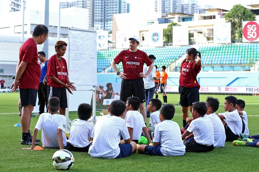 Community coaches speaking with children who were attending the Premier Skills Festival at Jalan Besar Stadium on July 14, 2015.
