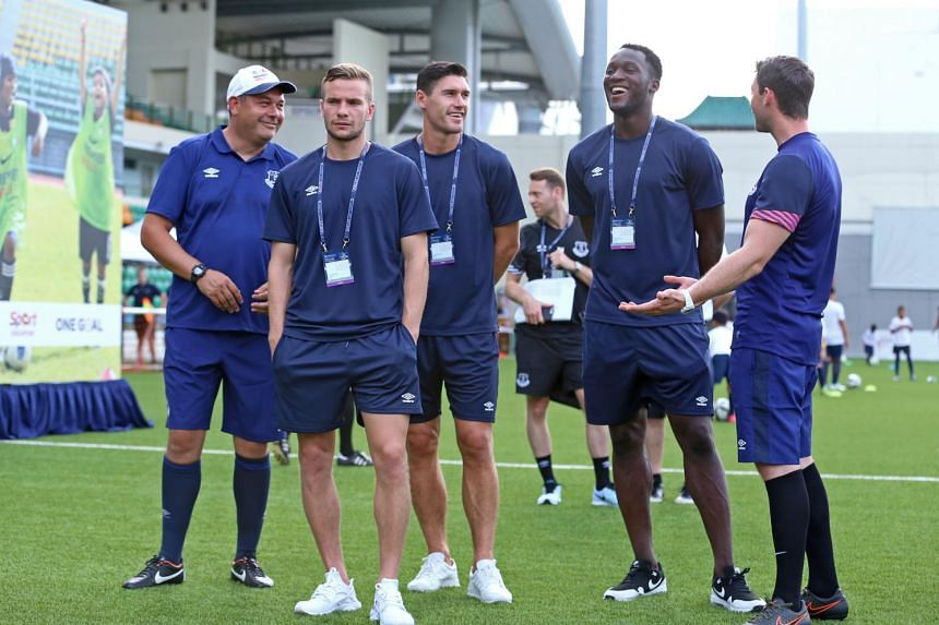 Everton players Tom Cleverley (second left), Gareth Barry (centre) and Romelu Lukaku (second right) at the Premier Skills Festival at Jalan Besar Stadium on July 14, 2015.