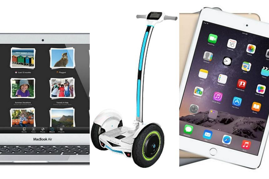 The top prizes are (from left) a MacBook Air, Airwheel S3 motorised scooter and iPad Mini.