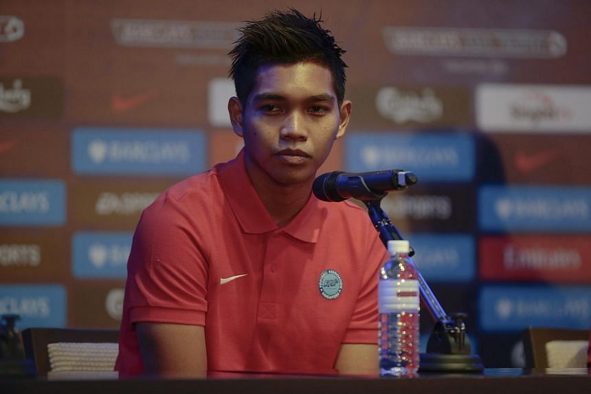 Singapore Selection goalkeeper Izwan Mahbud speaks to journalists at a press conference ahead of the Barclays Asia Trophy soccer tournament in Singapore.