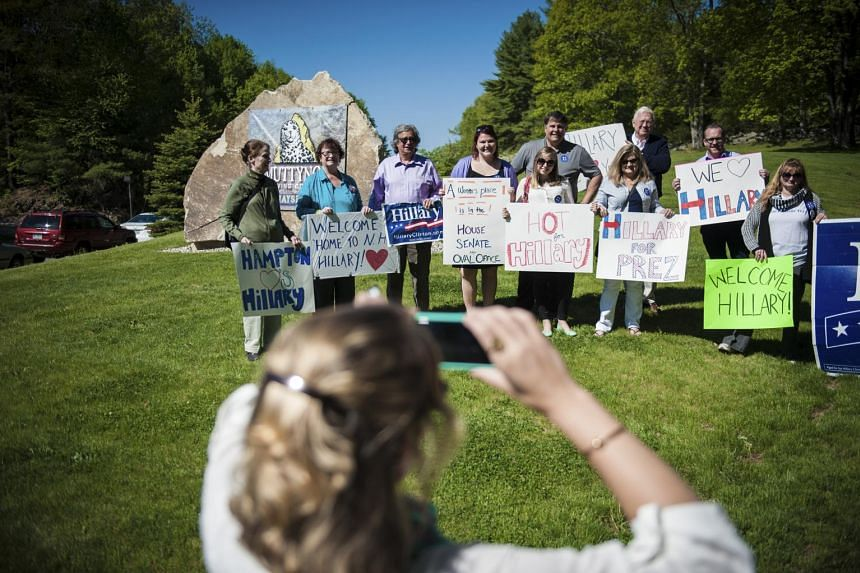 Supporters of Democratic presidential hopeful Hillary Clinton gathering outside Smuttynose Brewing Company, where Mrs Clinton held a roundtable discussion with the small business community in May.