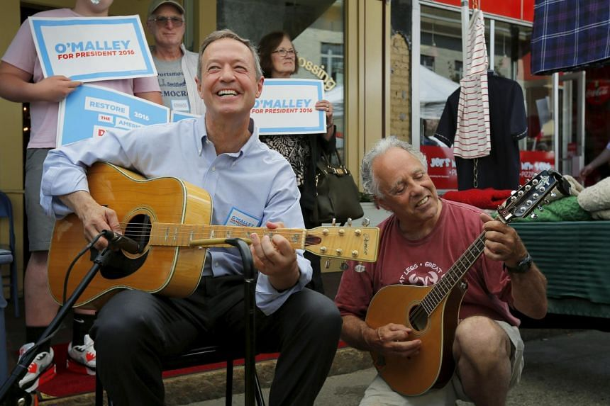Democratic candidate Martin O'Malley (sitting on a chair) jammed with a supporter in Portsmouth.
