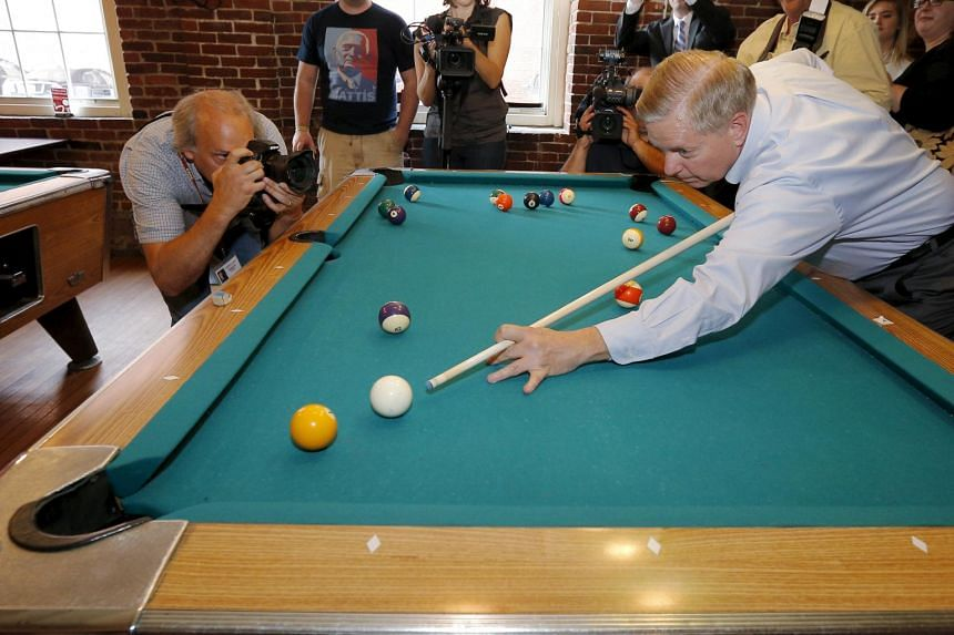 Senator Lindsey Graham, a Republican candidate, plays pool during a campaign stop in Manchester last month.
