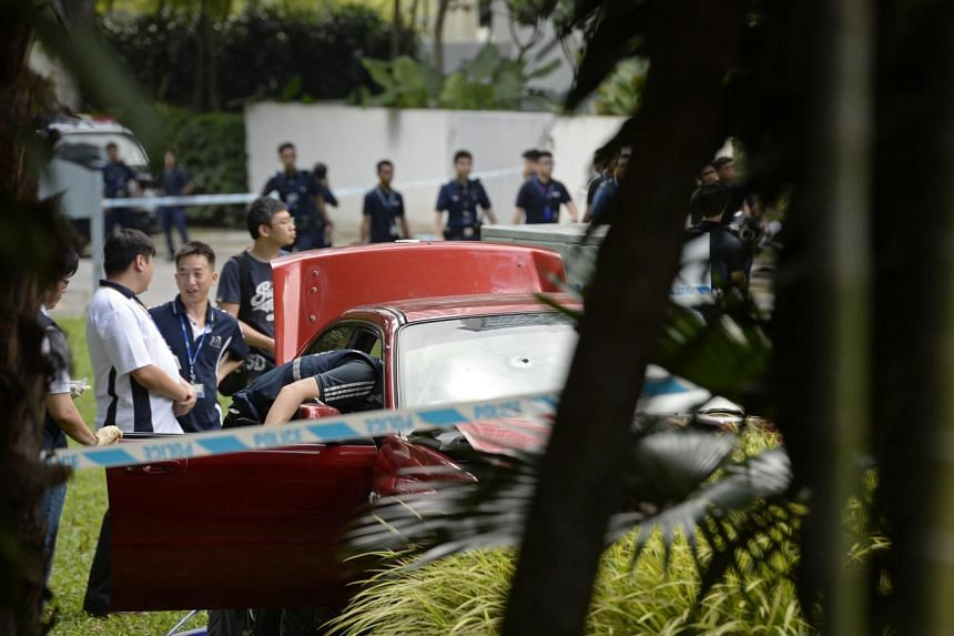 Police inspecting the car which crashed through security barriers near the Shangri-La Hotel on May 31.