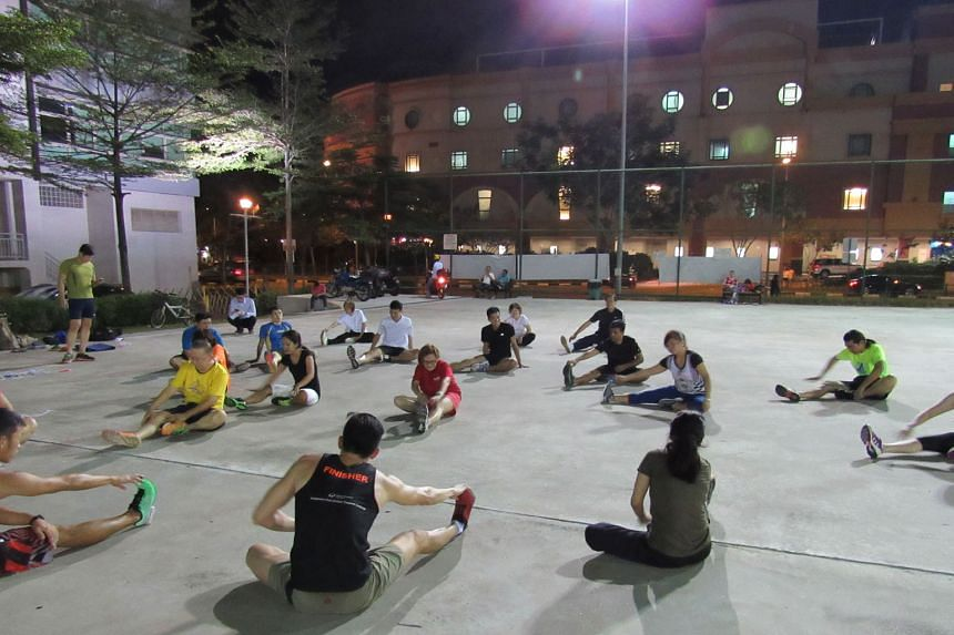 Heartland fitness challenge participants warm up by stretching. The challenge, over eight stations, will cost $15 each and is open to all, not just residents of Pasir Ris- Punggol GRC.
