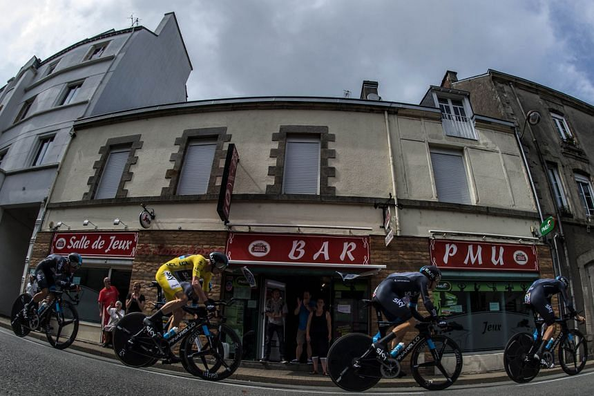 Britain's Sky cycling team, including Chris Froome, wearing the overall leader's yellow jersey, finished second, just 0.6sec behind winners BMC in the 28km team time-trial on Sunday.