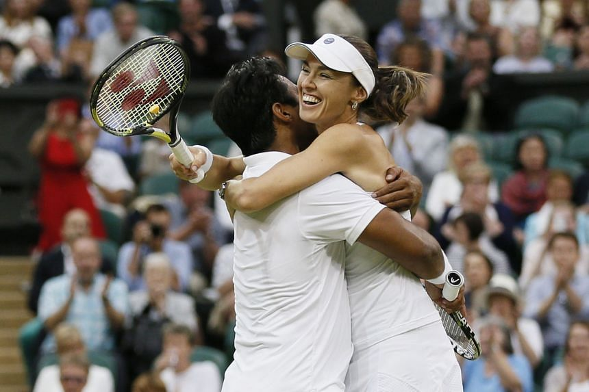 A resilient Martina Hingis won the mixed doubles crown with Leander Paes after bagging the women's doubles title the day before.