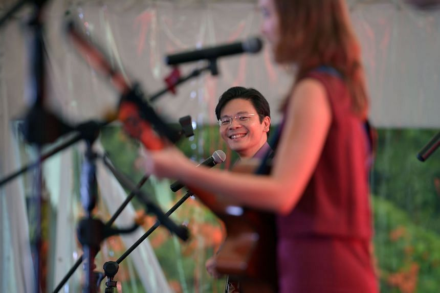 Minister Lawrence Wong performing on the guitar.