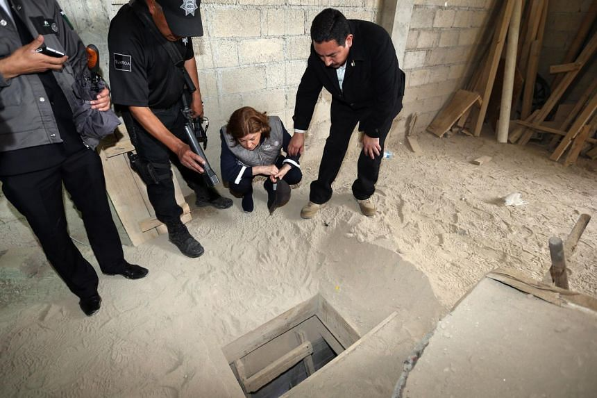 The Mexican authorities looking at the alleged end of the escape tunnel in a construction site in the neighbourhood of Santa Juanita. The 2km-long tunnel was more than 60cm wide and 1.5m high.