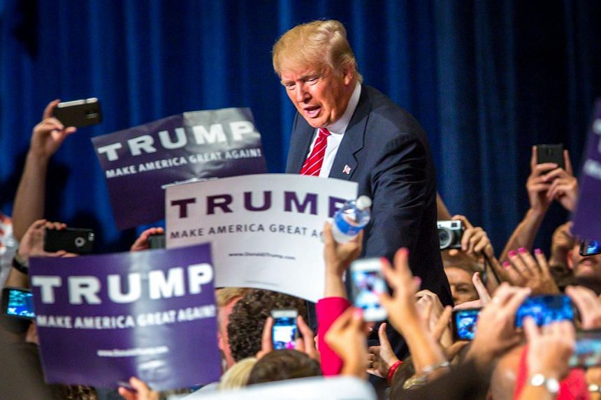 Republican Presidential candidate Donald Trump addresses supporters during a political rally at the Phoenix Convention Centre.