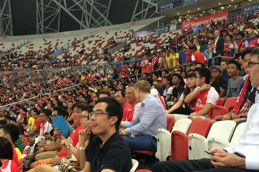 Arsenal fans flocked from all over the world to see their team take on Singapore in the Barclays Asia Trophy match on Wednesday.