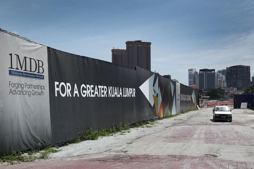 Signage for 1Malaysia Development is displayed at the site of the Tun Razak Exchange project in Kuala Lumpur.