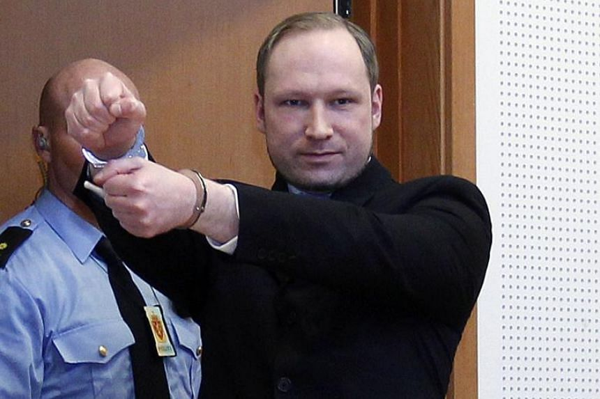 Anders Behring Breivik (right) arriving at the court for his hearing in Oslo, Norway, Feb 6, 2012.