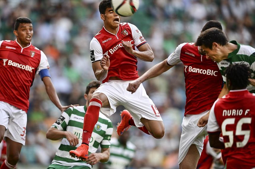 Braga's Brazilian midfielder Danilo (centre) heads the ball during the Portuguese league football match against Sporting CP, at the Jose Alvalade stadium in Lisbon on May 17, 2015.