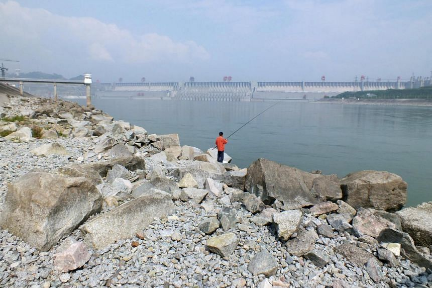 A man fishes in a reservoir near the Three Gorges Dam in Yichang, Hubei province, China.
