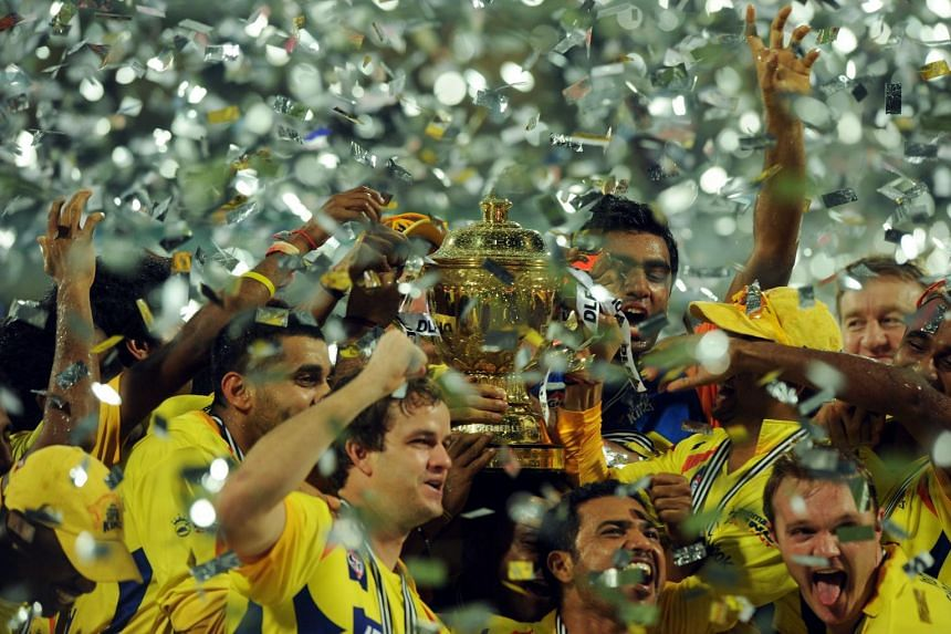 Chennai Super Kings players celebrate with the trophy after the IPL Twenty20 cricket final match between Chennai Super Kings and Royal Challengers Bangalore at The M.A.Chidambaram Stadium in Chennai on May 29, 2011.