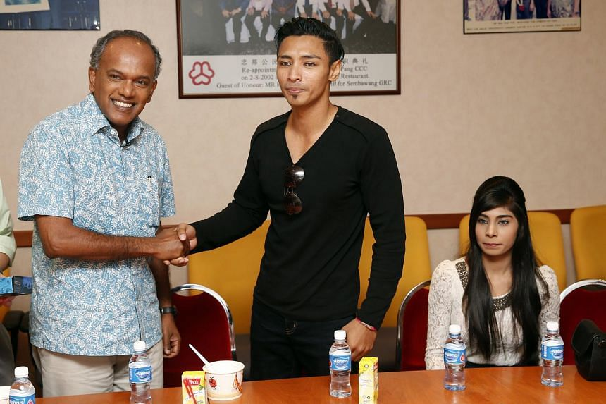 Law Minister K Shanmugam speaking with Mr Muhammad Hanafie Ali Mahmood and his girlfriend Nabilah Nasser at Chong Pang Community Club on Wednesday. Mr Shanmugam had earlier praised Mr Hanafie for standing up to a bully in the MRT.