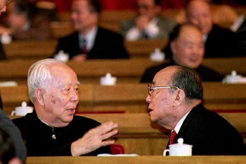 Then National People's Congress (NPC) Chairman Wan Li (left) chatting with Chinese President Yang Shangkun at the opening of the NPC on March 15, 1993.