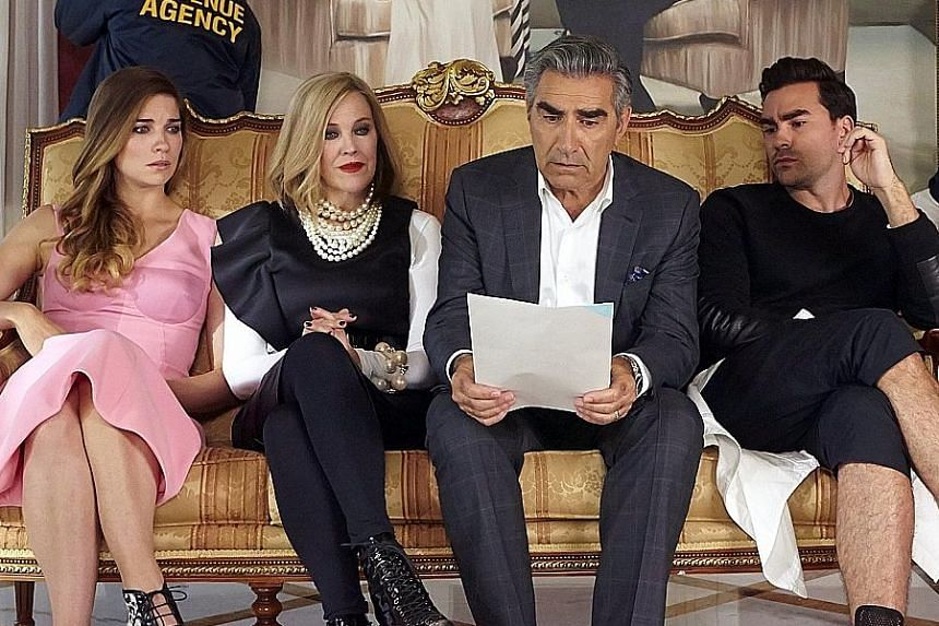Rhona Mitra in The Last Ship (above). The Schitt's Creek family is played by (from far left) Annie Murphy, Catherine O'Hara, Eugene Levy and Daniel Levy.
