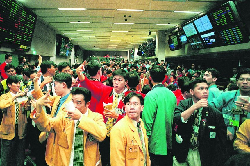Dealers in action during morning trading at the Singapore International Monetary Exchange in 1998.