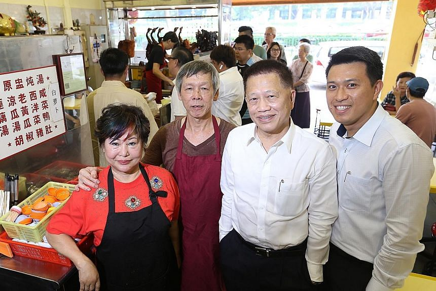 (From left) Madam Betty Kong and her husband Ha Wai Kay, who built up Kay Lee Roast Meat Joint, with Aztech Group chairman Michael Mun, who bought it for $4 million, and his eldest son Jeremy Mun.