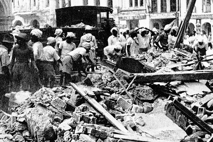 """Workmen clearing the rubble (left) following a Japanese air raid on Singapore in 1942. The back page of The Straits Times on Jan 30, 1942, carried """"An air raid alphabet"""" (below) for readers to cut out and keep for reference.PHOTO: ARGUS NEWSPAPER COL"""