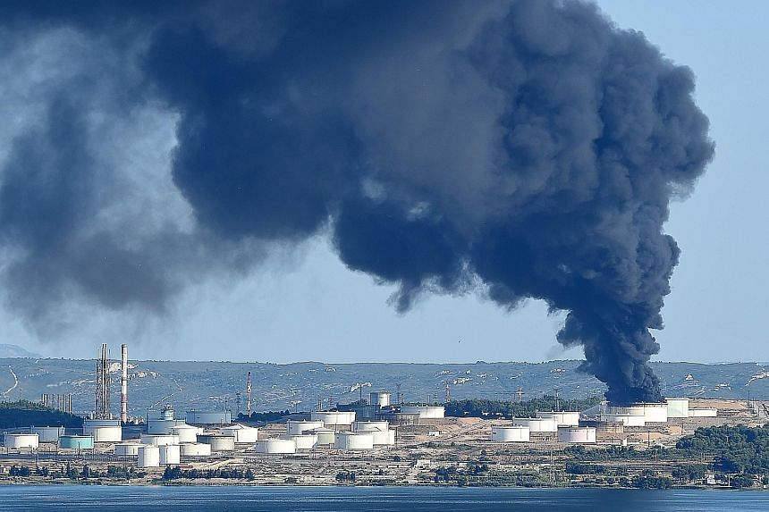 Smoke billowing from a fire at a petrochemical plant operated by LyondellBasell in Berre-l'Etang, near Marseilles, in southern France yesterday, after two explosions earlier in the morning, a source in the investigation said. Police said no one was i