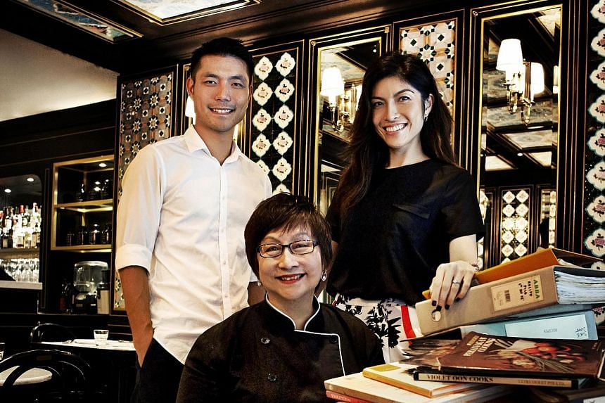 The name of the new restaurant by Ms Violet Oon (seated) and her children, Tay Yiming and Tay Su-lyn, has yet to be confirmed.
