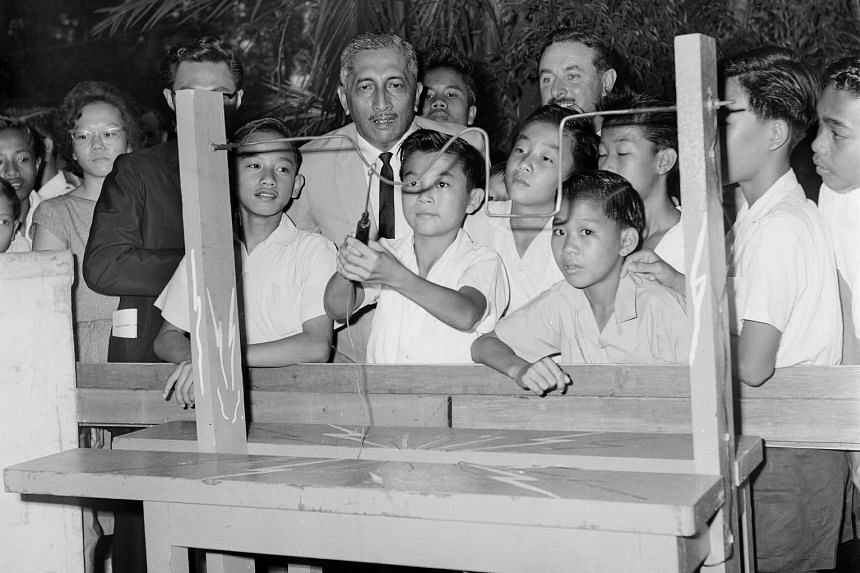 Mr Yusof Ishak with pupils at a fair in 1964. He was the country's head of state after it achieved self-government in 1959, and later became the first president of an independent Singapore. He played a key role in helping to restore the trust and con