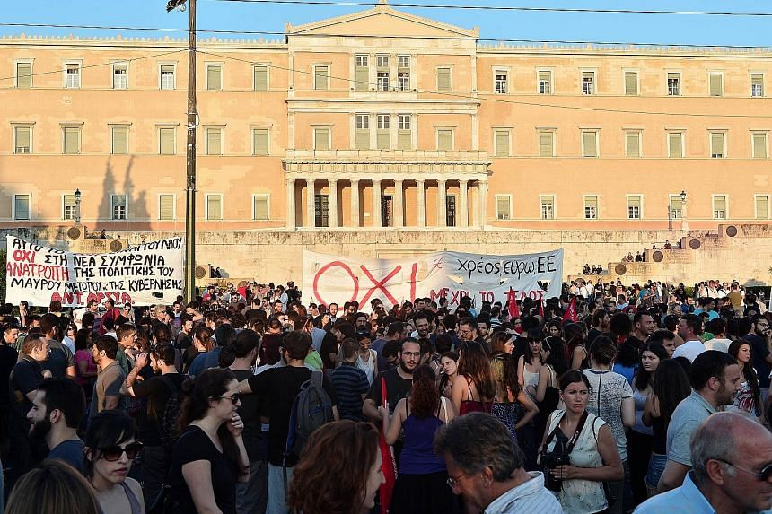Protesters in an anti-EU demonstration in Athens on Monday rallying against the deal struck between Greece and its European creditors. Under the deal, Athens must push through draconian reforms in a matter of days.