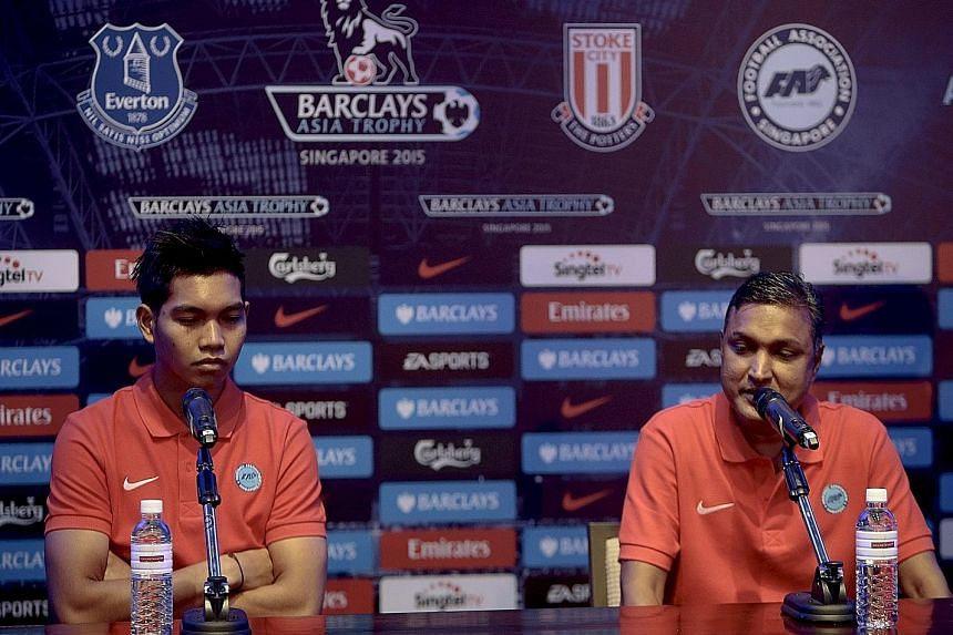 Singapore Selection goalkeeper Izwan Mahbud (left) and coach V. Sundramoorthy at a news briefing yesterday. Izwan has been earning rave reviews for his recent performances for the national team.