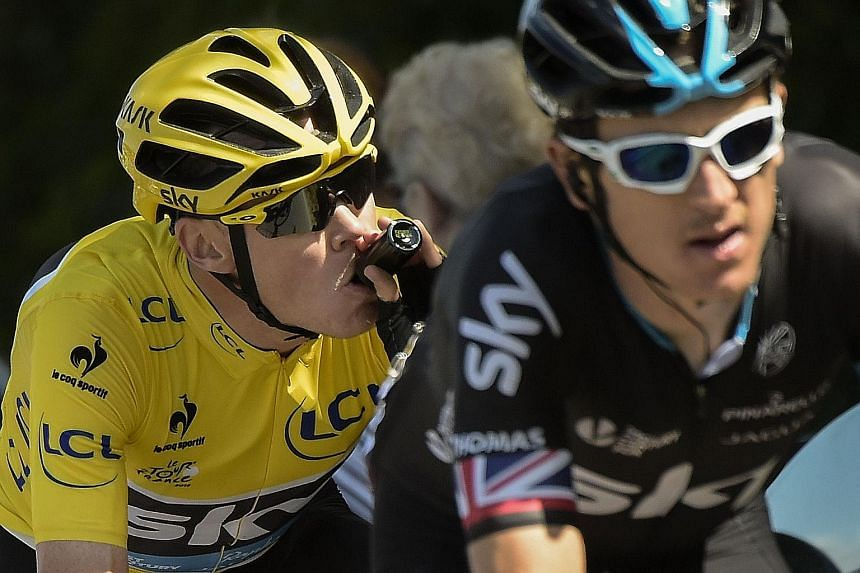 """Chris Froome (left), riding behind Geraint Thomas during the 181.5km eighth stage of the Tour de France, has spoken about """"clowns"""" who try to analyse figures and make allegations."""