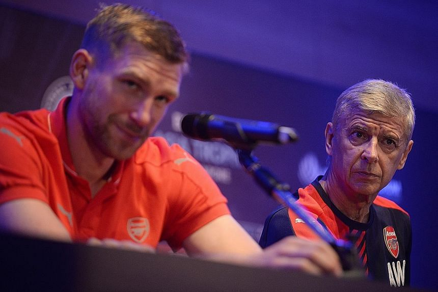 Arsene Wenger (right) is not ruling out any other new signings - as long as they can further strengthen the team - while Per Mertesacker insists that the Gunners must get off to a good start, unlike last season.