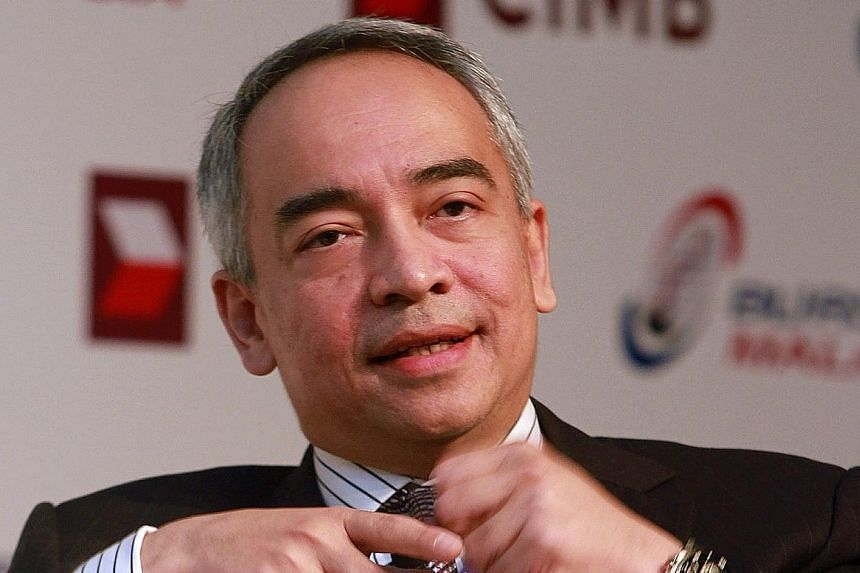 CIMB chief Nazir Razak (above) is setting up an NGO, with former Umno deputy minister Saifuddin Abdullah (right) as its public face.