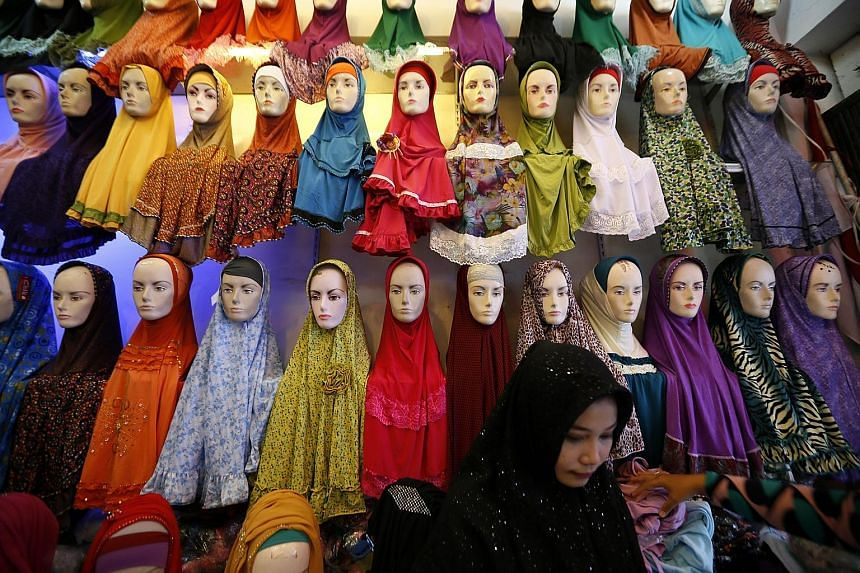 A range of traditional Muslim veils, or hijab, displayed for sale at a market in Banda Aceh. Retailers are reporting a sharp drop in business even as Muslims in Indonesia prepare to celebrate Idul Fitri, which marks the end of the Ramadan fasting mon