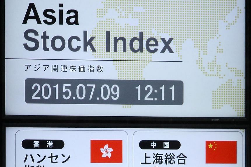 An electronic board displaying stock figures outside a securities firm in Tokyo.