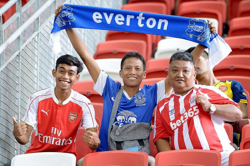 Everton and Stoke City fans cheering their teams at the National Stadium in Singapore on July 15, 2015.