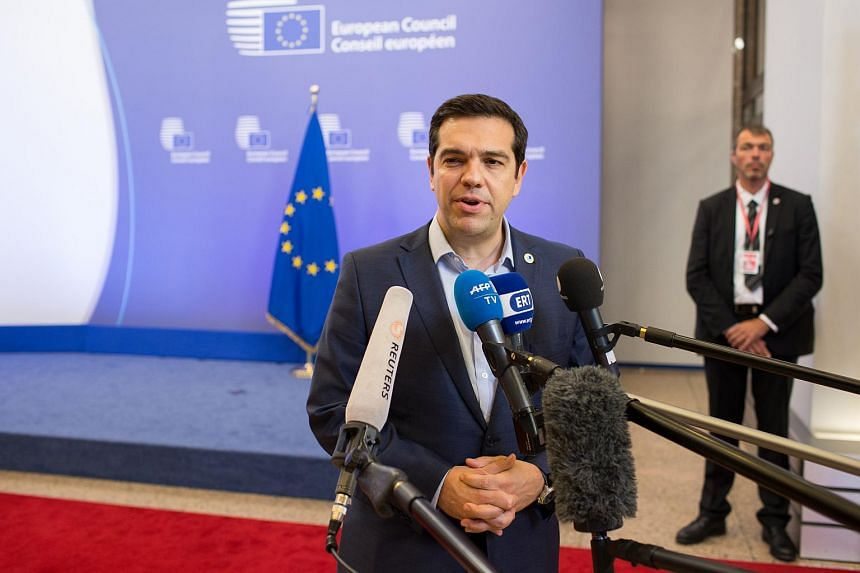Alexis Tsipras, speaks to journalists following all-night bailout talks in Brussels on Monday, July 13, 2015.